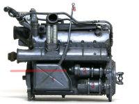 エンジンの右側。1:オイルタンク、2:手動起動装置、3:電動起動装置、4:オイル点検用棒